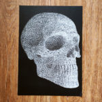 white ink pen paint skull